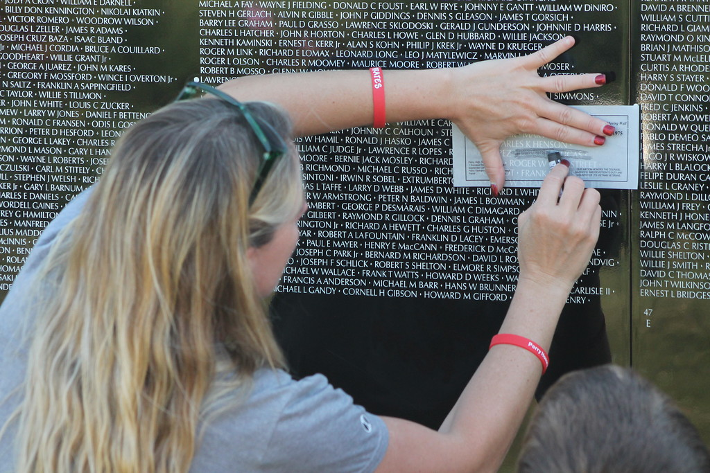 . Kristi Garabrandt � The News-Herald <br> Melinda Allen of Beallsville, came to The Wall to get etchings the etchings of the names on The Wall from her city to take back for their family members Sept. 21.