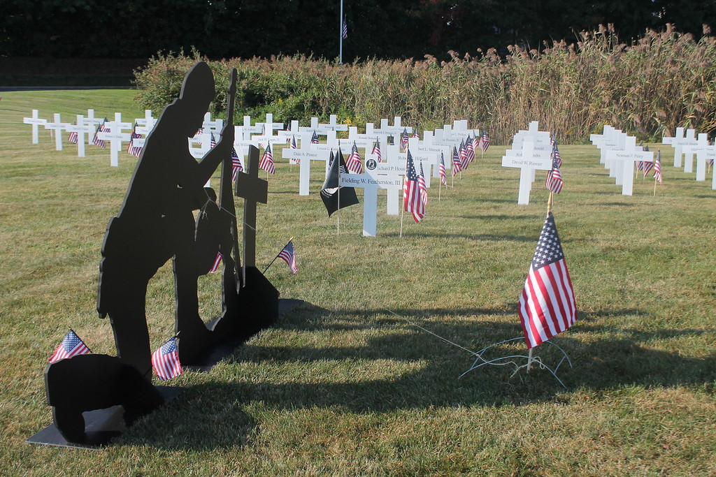 . Kristi Garabrandt � The News-Herald <br> A memorial was set up  along with the Moving Wall to pay tribute to Lake County\'s 56 fallen heroes who lost their lives serving in Vietnam, including one MIA who was declared dead.