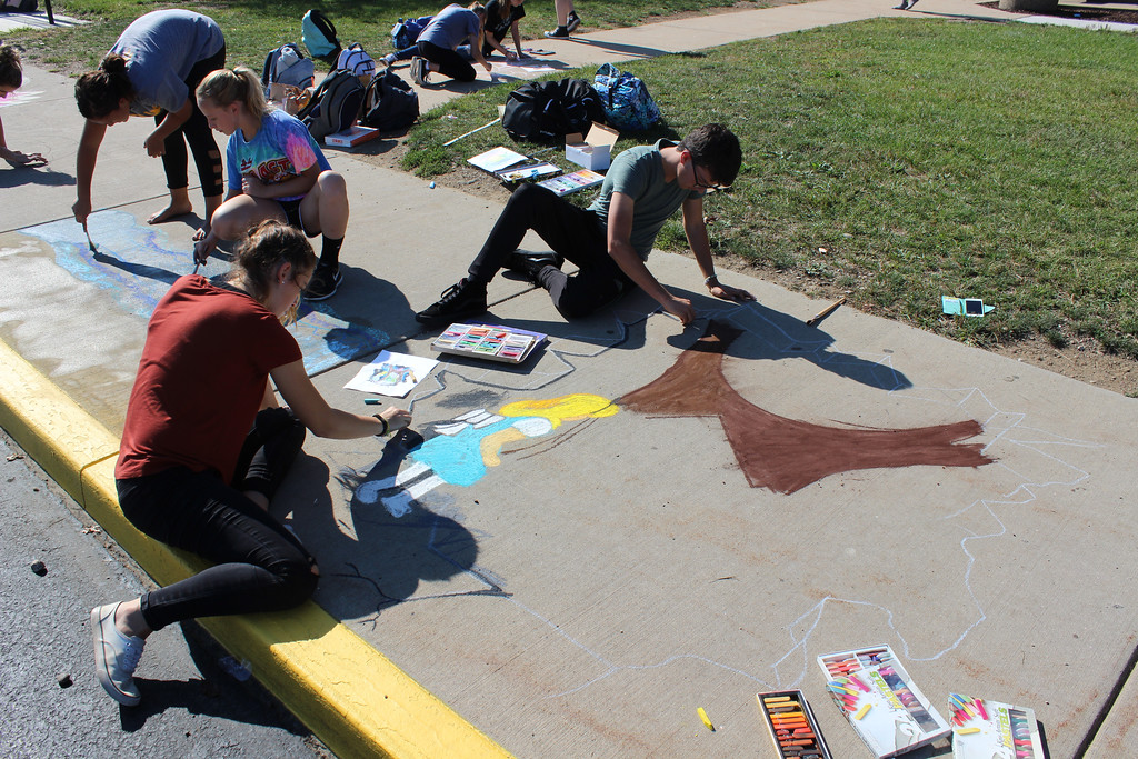 . Riverside High School art students participate in Chalkfest on Sept. 21. (Tawana Roberts - The News-Herald)