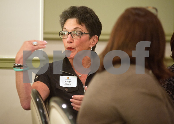 photo by Sarah A. Miller/Tyler Morning Telegraph  Margo Adams of Tyler gets involved in a conversation about improving education Thursday at the Leaders in Education Luncheon held at Willow Brook County Club in Tyler.