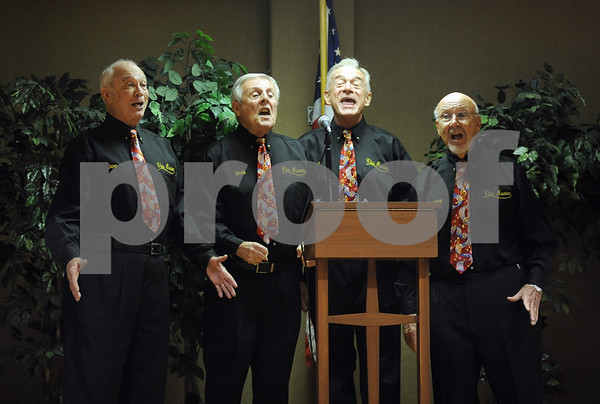 photo by Sarah A. Miller/Tyler Morning Telegraph  Members of the Class Reunion Barbershop Quartet perform at the Meals On Wheels 38th anniversary luncheon fundraiser Wednesday at First Christian Church in Tyler. Meals on Wheels provides meals to homebound elderly and disabled people.