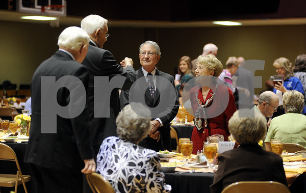 photo by Sarah A. Miller/Tyler Morning Telegraph  Meals on Wheels staff, supporters and guests including Sam Whitten and Karen Whitten of Athens, at right, mingle before food is served at the Meals On Wheels 38th anniversary luncheon fundraiser Wednesday at First Christian Church in Tyler. Meals on Wheels provides meals to homebound elderly and disabled people.