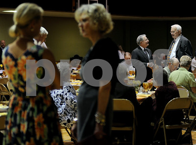 photo by Sarah A. Miller/Tyler Morning Telegraph  Meals on Wheels staff, supporters and guests including Sam Whitten and Ken Davis of Athens, at right, mingle before food is served at the Meals On Wheels 38th anniversary luncheon fundraiser Wednesday at First Christian Church in Tyler. Meals on Wheels provides meals to homebound elderly and disabled people.