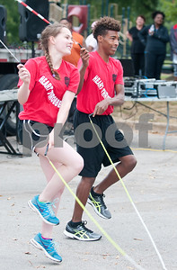 Mariah Berg, 19, and Ashtian Horton, 16, perform with the Heart Throbbers jump rope team at Woldert Park after the annual Community Faith-Based Health Walk to promote living a healthy lifestyle Saturday Oct. 10, 2015. Nearly 200 people completed the one and a half mile walk starting and ending at the park.  (Sarah A. Miller/Tyler Morning Telegraph)