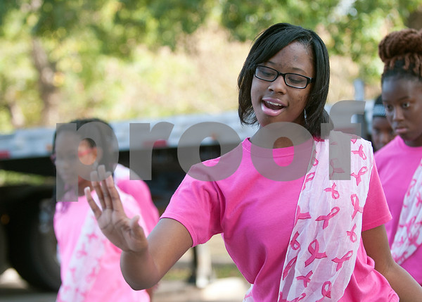 Iyana Johnson, 16, performs with the New Jerusalem Baptist Church praise dance team after the annual Community Faith-Based Health Walk to promote living a healthy lifestyle Saturday Oct. 10, 2015 at Woldert Park in Tyler. Nearly 200 people completed the one and a half mile walk starting and ending at the park.  (Sarah A. Miller/Tyler Morning Telegraph)
