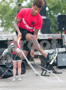 Ashtian Horton, 16, performs with the Heart Throbbers jump rope team at Woldert Park after the annual Community Faith-Based Health Walk to promote living a healthy lifestyle Saturday Oct. 10, 2015. Nearly 200 people completed the one and a half mile walk starting and ending at the park.  (Sarah A. Miller/Tyler Morning Telegraph)