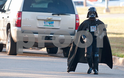 Nayati Ates, 9, walks the walk in her Darth Vader Halloween costume at the annual Community Faith-Based Health Walk to promote living a healthy lifestyle Saturday Oct. 10, 2015 at Woldert Park in Tyler. Nearly 200 people completed the one and a half mile walk starting and ending at the park.  (Sarah A. Miller/Tyler Morning Telegraph)