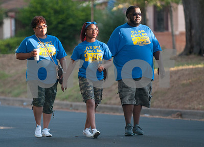 Tamara Johnson, her daughter Tamia Isabell, 14, and husband James Johnson, pastor of Pleasant Grove Baptist Church, walk in the third annual Community Faith-Based Health Walk to promote living a healthy lifestyle Saturday Oct. 10, 2015. Nearly 200 people completed the one and a half mile walk starting and ending at Woldert Park in Tyler, Texas. Heart disease, cancer and stroke are the leading causes of death for African Americans and event organizers hoped to curb that trend by encouraging black church leaders and congregations to attend the event.    (Sarah A. Miller/Tyler Morning Telegraph)