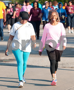 Anita Smith and Dorothy Wideman Davis of St. Louis Baptist Church walk in the annual Community Faith-Based Health Walk to promote living a healthy lifestyle Saturday Oct. 10, 2015 at Woldert Park in Tyler. Nearly 200 people completed the one and a half mile walk starting and ending at the park.  (Sarah A. Miller/Tyler Morning Telegraph)