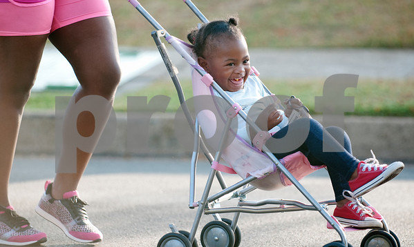 Shay Franklin of Tyler pushes her daughter Londyn Shears, 2, in a stroller as she participates in the third annual Community Faith-Based Health Walk to promote living a healthy lifestyle Saturday Oct. 10, 2015. Shears attends The Cross Baptist Church. Nearly 200 people completed the one and a half mile walk starting and ending at Woldert Park in Tyler, Texas. Heart disease, cancer and stroke are the leading causes of death for African Americans and event organizers hoped to curb that trend by encouraging black church leaders and congregations to attend the event.    (Sarah A. Miller/Tyler Morning Telegraph)
