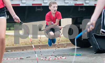 Bradley Koop performs with the Heart Throbbers jump rope team at Woldert Park after the annual Community Faith-Based Health Walk to promote living a healthy lifestyle Saturday Oct. 10, 2015. Nearly 200 people completed the one and a half mile walk starting and ending at the park.  (Sarah A. Miller/Tyler Morning Telegraph)