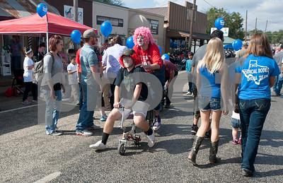Clowns roam the street at the Van Oil Festival Saturday.  (Sarah A. Miller/Tyler Morning Telegraph)