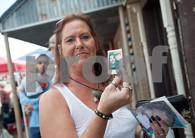 Tammi Mims holds a photo she recovered Saturday from the National Disaster Photo Rescue booth at the Van Oil Festival. Mims recovered the photo of her husband from their first date as well as several other family photos she lost in the May tornado that destroyed her house.  (Sarah A. Miller/Tyler Morning Telegraph)
