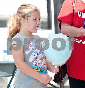 Hannah Stewart, 6, of Van, eats cotton candy at the Van Oil Festival Saturday.  (Sarah A. Miller/Tyler Morning Telegraph)