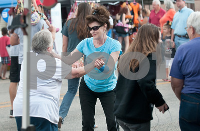Cousins Carla Shelton of Orange and Kathy Lewis of Van dance at the Van Oil Festival Saturday.  (Sarah A. Miller/Tyler Morning Telegraph)