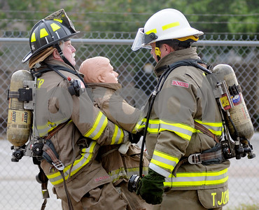 photo by Sarah A. Miller/Tyler Morning Telegraph  Tyler fire chief Tim Johnson, right, spots Dave McCoung as he pulls a dummy to practice Thursday morning for the Brookshire Firefighters Combat Challenge. Fit City competitors Mark McDainel, Tyler city manager and Nelson Clyde, Tyler Morning Telegraph Publisher, are expected to compete Saturday with their teams in the Brookshire Firefighters Combat Challenge at the Broadway Square Mall parking lot. The event kicks off 4:30 Friday and resumes Saturday at 9:30 a.m., drawing firefighters from around the United States and beyond to compete.