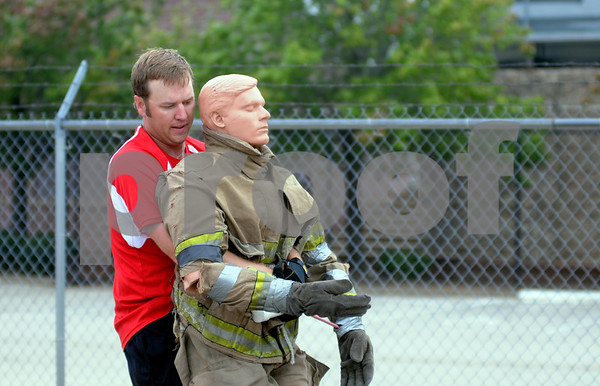 photo by Sarah A. Miller/Tyler Morning Telegraph  Tyler city arborist Luke Porter pulls a dummy to practice Thursday morning for the Brookshire Firefighters Combat Challenge. Fit City competitors Mark McDainel, Tyler city manager and Nelson Clyde, Tyler Morning Telegraph Publisher, are expected to compete Saturday with their teams in the Brookshire Firefighters Combat Challenge at the Broadway Square Mall parking lot. The event kicks off 4:30 Friday and resumes Saturday at 9:30 a.m., drawing firefighters from around the United States and beyond to compete.