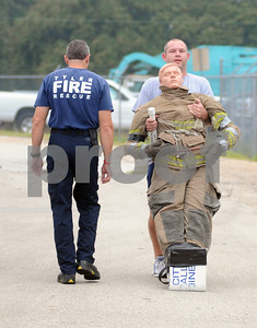 photo by Sarah A. Miller/Tyler Morning Telegraph  Tyler Morning Telegraph reporter Adam Russell pulls a dummy to practice Thursday morning for the Brookshire Firefighters Combat Challenge. Fit City competitors Mark McDainel, Tyler city manager and Nelson Clyde, Tyler Morning Telegraph Publisher, are expected to compete Saturday with their teams in the Brookshire Firefighters Combat Challenge at the Broadway Square Mall parking lot. The event kicks off 4:30 Friday and resumes Saturday at 9:30 a.m., drawing firefighters from around the United States and beyond to compete.