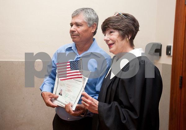 photo by Sarah A. Miller/Tyler Morning Telegraph  Tyler resident Ysidro Delgado of Mexico has his photo taken with the Honorable Judith Guthrie after the naturalization ceremony where he became a United States citizen at the U.S. District Courthouse in Tyler Thursday.