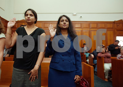 photo by Sarah A. Miller/Tyler Morning Telegraph  United States citizenship candidates Bhagyalakshmi Raghunandan and Shylashree Edalur, both of India, raise their hands to take the oath of citizenship during the naturalization ceremony at the U.S. District Courthouse in Tyler Thursday.
