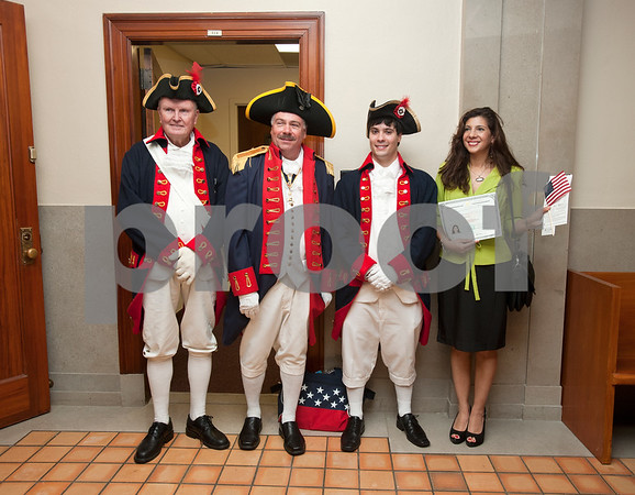 photo by Sarah A. Miller/Tyler Morning Telegraph  Tyler resident Magali Terry of Peru has her photograph taken with Sons of the American Revolution members Tim West, Steven Lee and Britton Lee after the naturalization ceremony where she became a United States citizen at the U.S. District Courthouse in Tyler Thursday.