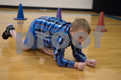 Velma Penny Elementary first grader Brayden Krohn, 6, practices how he would crawl to an exit if he was in a room filled with smoke during a  Fire Prevention Week educational program put on by the Lindale Volunteer Fire Department Wednesday Oct. 11, 2017.  (Sarah A. Miller/Tyler Morning Telegraph)