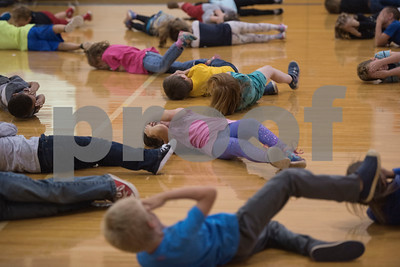 First graders at Lindale Independent School District's Velma Penny Elementary practice how they would stop, drop and roll if they were on fire during a  Fire Prevention Week educational program put on by the Lindale Volunteer Fire Department Wednesday Oct. 11, 2017.  (Sarah A. Miller/Tyler Morning Telegraph)