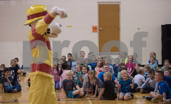 Sparky the fire dog visits first graders at Lindale Independent School District's Velma Penny Elementary  during a  Fire Prevention Week educational program put on by the Lindale Volunteer Fire Department Wednesday Oct. 11, 2017.  (Sarah A. Miller/Tyler Morning Telegraph)
