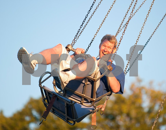 Joseph Mayo of Tyler rides a swing at the East Texas State Fair in Tyler, Texas Thursday evening Oct. 1, 2015. The fair closes Sunday night.  (Sarah A. Miller/Tyler Morning Telegraph)