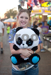 Macy Rushing of Tyler holds a stuffed animal she won at the East Texas State Fair in Tyler, Texas Thursday evening Oct. 1, 2015. The fair closes Sunday night.  (Sarah A. Miller/Tyler Morning Telegraph)