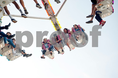 Fairgoers ride a ride at the East Texas State Fair in Tyler, Texas Thursday evening Oct. 1, 2015. The fair closes Sunday night.  (Sarah A. Miller/Tyler Morning Telegraph)