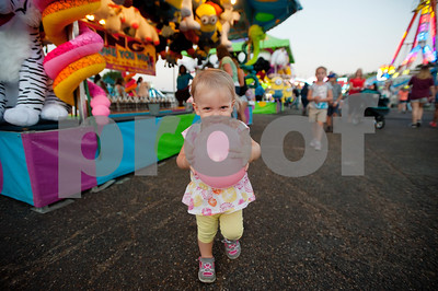 Addison Hill, 1, of Tyler, walks with a balloon at the East Texas State Fair in Tyler, Texas Thursday evening Oct. 1, 2015. The fair closes Sunday night.  (Sarah A. Miller/Tyler Morning Telegraph)