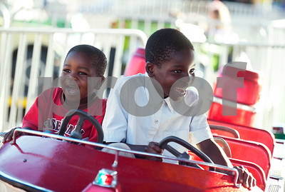 Brothers London Madlock, 4, and Tristian Madlock, 7, of Tyler, ride a children's boat ride at the East Texas State Fair in Tyler, Texas Thursday evening Oct. 1, 2015. The fair closes Sunday night.  (Sarah A. Miller/Tyler Morning Telegraph)
