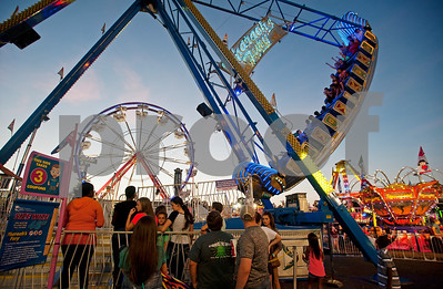 People wait in line to ride rides at the East Texas State Fair in Tyler, Texas Thursday evening Oct. 1, 2015. The fair closes Sunday night.  (Sarah A. Miller/Tyler Morning Telegraph)