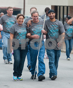 photo by Sarah A. Miller/Tyler Morning Telegraph  Horizon Industries employees Paquita Felix, Tony Powers and Randal Ruiz, all of Tyler, participate in the annual White Cane Walk held by The Lighthouse, an East Texas nonprofit that assists blind residents in the community Monday October 15 in downtown Tyler, Texas. Horizon Industries is a division of The Lighthouse that employs blind and visually impaired people. The annual walk honors White Cane Day, nationally designated as Oct. 15, by President Lyndon B. Johnson recognizing the importance of the white cane as a symbol of independence for blind people.
