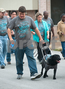 photo by Sarah A. Miller/Tyler Morning Telegraph  Horizon Industries employee Seth Wilson of Tyler walks with his service dog named De Soto in the annual White Cane Walk Monday October 15 in downtown Tyler, Texas. The event was held by The Lighthouse, an East Texas nonprofit that assists blind residents in the community. The annual walk honors White Cane Day, nationally designated as Oct. 15, by President Lyndon B. Johnson recognizing the importance of the white cane as a symbol of independence for blind people. Horizon Industries is a division of The Lighthouse that employs blind and visually impaired people.