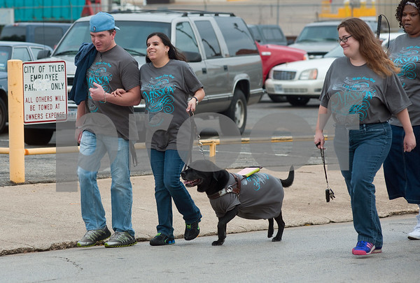 photo by Sarah A. Miller/Tyler Morning Telegraph  Visually impaired Horizon Industries employees Jason Toole, Ina Artega, her service dog Jasmine and co-worker Christy Clemmer, all of Tyler, walk in the annual White Cane Walk Monday October 15 in downtown Tyler, Texas. The event was held by The Lighthouse, an East Texas nonprofit that assists blind residents in the community. The annual walk honors White Cane Day, nationally designated as Oct. 15, by President Lyndon B. Johnson recognizing the importance of the white cane as a symbol of independence for blind people. Horizon Industries is a division of The Lighthouse that employs blind and visually impaired people.