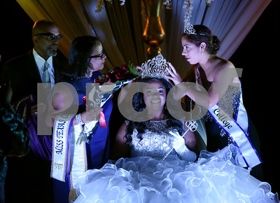 Former Miss Texas College Paloma Bermudez, right, crowns Taylor J. Pierce as the 122nd Miss Texas College Thursday Oct. 20, 2016. Texas College President Dr. Dwight J. Fennell and his wife Angelia Fennell, at left, participated in the ceremony. Pierce will serve as Miss Texas College for the remainder of the 2016-17 academic year acting as a student ambassador for the college.  (Sarah A. Miller/Tyler Morning Telegraph)