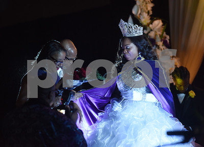 Texas College President Dr. Dwight J. Fennell and his wife Angelia Fennell, at left, place robes upon Taylor J. Pierce, the 122nd Miss Texas College during her coronation ceremony Thursday Oct. 20, 2016.  Pierce will serve as Miss Texas College for the remainder of the 2016-17 academic year acting as a student ambassador for the college.  (Sarah A. Miller/Tyler Morning Telegraph)