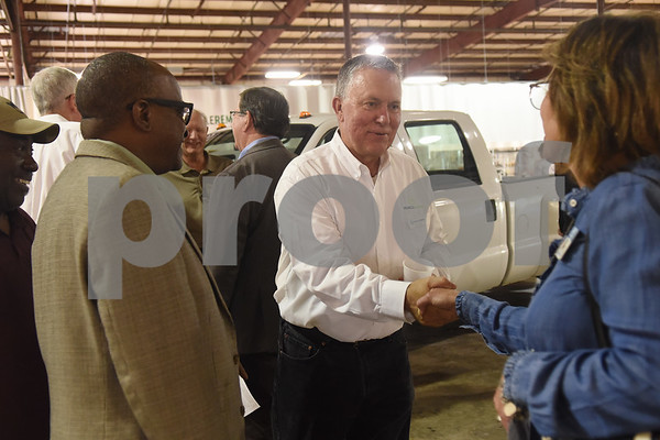 Steve Belden, director of marketing for Vehicle Reman, shakes hands with Jenni Wilson of the Tyler Chamber of Commerce during an open house and ribbon cutting ceremony Thursday at the 60,000-square-foot facility in Tyler. Vehicle Reman takes old vehicles and remanufactures them to make them like new again.  (Sarah A. Miller/Tyler Morning Telegraph)