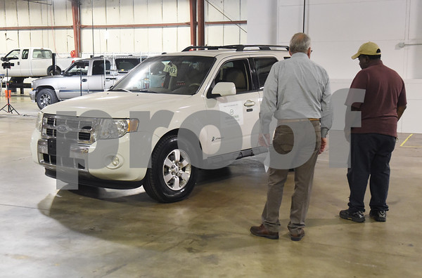 Tyler City Councilmen Don Warren and Ed Moore Vehicle Reman during an open house and ribbon cutting ceremony Thursday at the 60,000-square-foot facility in Tyler. Vehicle Reman takes old vehicles and remanufactures them to make them like new again.  (Sarah A. Miller/Tyler Morning Telegraph)