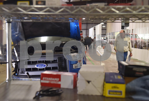 Jerome Howard tours Vehicle Reman during an open house and ribbon cutting ceremony Thursday at the 60,000-square-foot facility in Tyler. Vehicle Reman takes old vehicles and remanufactures them to make them like new again.  (Sarah A. Miller/Tyler Morning Telegraph)