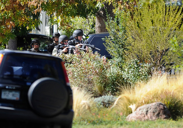 """City of Boulder Swat Team members work to extract a man with a gun from a home in the 3200 block of Euclid Avenue in Boulder on Tuesday, Oct. 2. For more photos and video of the SWAT Team in action go to  <a href=""""http://www.dailycamera.com"""">http://www.dailycamera.com</a><br /> Jeremy Papasso/ Camera"""