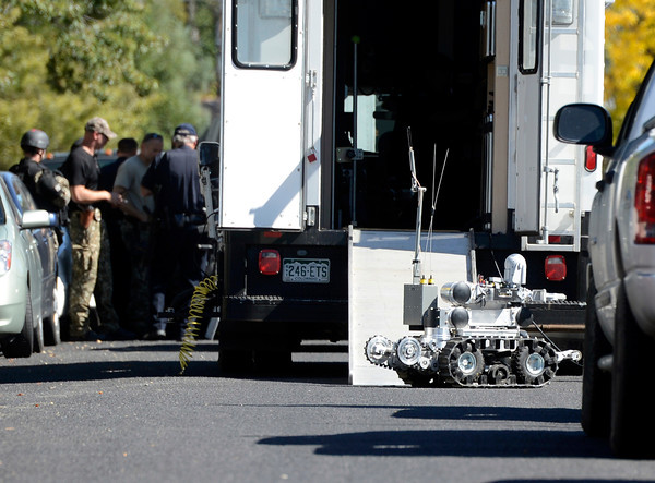 City of Boulder SWAT members, left, get ready while a robotic device heads towards the home where a man was allegedly armed and in a standoff with police on Tuesday, Oct. 2, in the 3200 block of Euclid Avenue in Boulder.<br /> Jeremy Papasso/ Camera