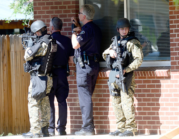 SWAT and Boulder Police cover a house where a man has broken in drunk and is armed with a gun near Euclid Ave and Quinn in Boulder, Colorado October 2, 2012.  DAILY CAMERA/ MARK LEFFINGWELL