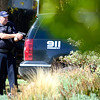 Police cover a house where a man has broken in drunk and is armed with a gun near Euclid Ave and Quinn in Boulder, Colorado October 2, 2012.  DAILY CAMERA/ MARK LEFFINGWELL