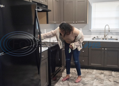 Brea Woods, 17, checks out the new oven in the home she and her mom will live in thanks to Habitat of Humanity on Friday, Oct. 25, 2019. Their new home in Tyler is the 108th home built in Smith County in Habitat's 30-year history.    (Sarah A. Miller/Tyler Morning Telegraph)
