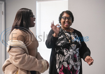 Brea Woods, 17, smiles as her mother Scherry Jones, 53, shows off her house keys after becoming a first-time home owner thanks to Habitat of Humanity of Smith County on Friday, Oct. 25, 2019. Their new home in Tyler is the 108th home built in Smith County in Habitat's 30-year history.    (Sarah A. Miller/Tyler Morning Telegraph)