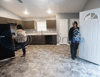Brea Woods, 17, and her mother Scherry Jones, 53, take a look at the finishing touches of their Habitat of Humanity home on Friday, Oct. 25, 2019. Their new home in Tyler is the 108th home built in Smith County in Habitat's 30-year history.    (Sarah A. Miller/Tyler Morning Telegraph)