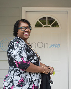 Scherry Jones, 53, stands outside of her front door with the keys to her new home during her home closing with Habitat of Humanity of Smith County on Friday, Oct. 25, 2019. Jones' new home in Tyler is the 108th home built in Smith County in Habitat's 30-year history.    (Sarah A. Miller/Tyler Morning Telegraph)